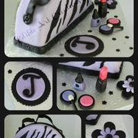 My First Purse/make-Up Cake :) Zebra print, all fondant with fondant/tylose accessories. The cake is also zebra inside.