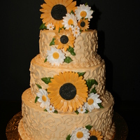 Sunflowers And Daisies ivory buttercream covered cake with gumpaste sunflowers and daisies