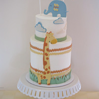 First Birthday Cake I made this cake for my son's first birthday. It is a double barrel, buttercream iced cake with fondant and gumpaste decorations....