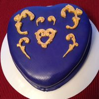 Golden Accents On Purple Heart-Shaped Cake.
