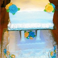"25Th Anniversary 8"" and 10"" square 2 tier cake w/ mirror bases. Royal icing flowers w/ buttercream leaves.(the cake was actually made for a friend..."