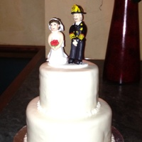 My First Wedding Cake The Groom Is A Fire Chief I Had Trouble With It Having Air Bubbles My first wedding cake. The groom is a fire chief. I had trouble with it having air bubbles.
