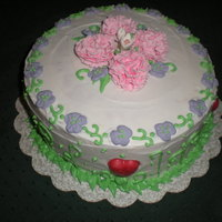 Carnations And Floweres Gumpaste/fondant carnations and stepanotis, royal icing flowers and leaves, buttercream frosting. The royal icing leaves and vilets...