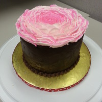 Giant Buttercream Rose Cake   Chocolate cake covered in chocolate ganache topped with giant buttercream rose.