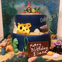 Little Mermaid Cake Marble cake covered in fondant with gumpaste decorations and crushed graham crackers for sand. Disney characters are plastic.