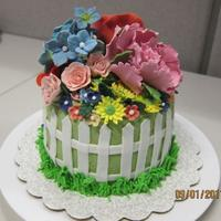 Garden Cake Red velvet cake covered with buttercream and gumpaste flowers for my friend Alice.