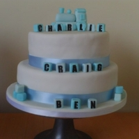 Christening Cake My first two tier cake the train and building blocks are made out of fondant