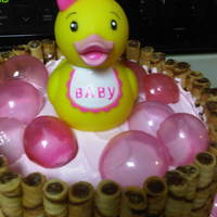 Pink Duckies This is a pirouline wrapped cake with chocolate ducks pressed into the bottom layer. The gelatin bubbles were a hit! My first time, and I...