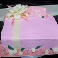 Pink Gift Box First birthday cake with candy clay bow & ribbon roses.