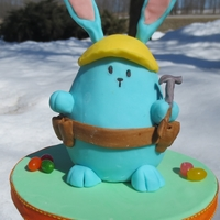 "Construction Bunny Mini bunny cake on a 6"" base."