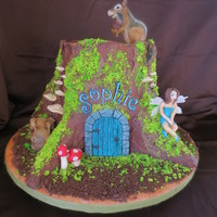 "Woodland Fairy Cake Fairy cake for a little girl. The stump is iced in ganache with cake crum moss. The ""legs"" of the stump are cereal treats, as are..."