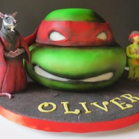 Teenage Mutant Ninja Turtles Cake TMNT cake for a friend's little boy. The figure on the right is the birthday boy in a TMNT costume.