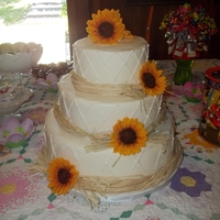 Sunflower, Cheesecake Wedding Cake I was nervous about this one! The cake is cheesecake. Very rustic setting. gumpaste sunflowers, textured buttercream quilting, and craft...