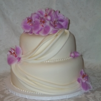Orchids And Drapes fondant decor and silk orchids.