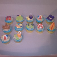 Beach Cupcakes Swirled blue and yellow vanilla cake. Buttercream with fondant accents.