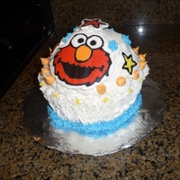 Giant Elmo Cupcake My son's smash cake for his first birthday... it is a giant cupcake with FBCT..