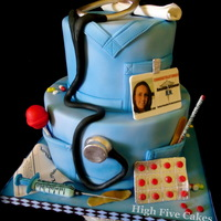 Nursing Grad 2 tiered graduation cake for RN. All edible materials. Accents are sculpted using gumpaste and fondant.