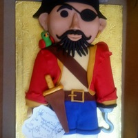 Pirate Cake A friendly pirate cake that was carved from cake and dressed in fondant. His hook and sword handle are dried and painted gumpaste. His...