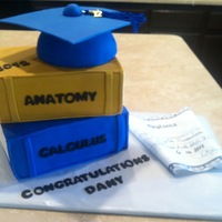 Graduation Books, Cap And Diploma Fun grad cake done for a friend, cap was ball pan and card board covered in fondant. Edible paper diploma.