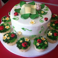 Daisies And Ladybugs Baby shower cake with daisies and ladybugs, buttercream with fondant details.