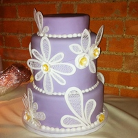 Kelly's Lavender Cake   Fondant covered, pieces are cut out fondant and royal icing.