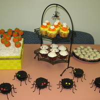 "Halloween Cupcake Display chocolate/peanut butter spider cupcakes, red velvet ""vampire bite"" cupcakes, caramel apple cupcakes decorated like candy corn,..."