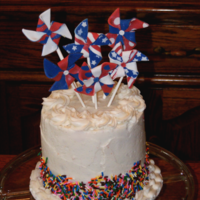 Memorial Day Pinwheels A Spumoni cake (cherry cake, chocolate cake, and pistachio buttercream) finished with vanilla buttercream and fondant pinwheels. Thank you...