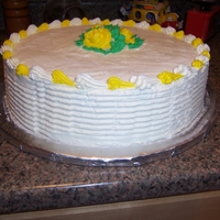 1324132599.jpg A yellow/White themed cake