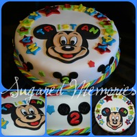 Mickey Mouse! Fondant covered marble cake w/ chocolate buttercream. Fondant disco dusted stars and letters, small mickey silhouettes are also glittered,...