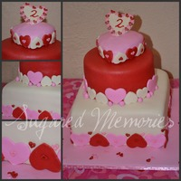 Valentine Birthday Valentine themed birthday cake, bottom tier is chocolate with peanut butter buttercream, second tier is red velvet and top tier is vanilla...