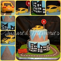 Camaro 8th birthday cake, he loves the camaro from Transformers so we tried to incorporate the main scene locations (desert and city) on the tiers...