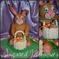 Brown Bunny Carved vanilla cake w/ Raspberry & Buttercream, head, arms and legs are RKT. Fondant accents for face and paws. Thanks for looking.....