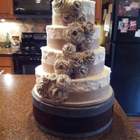 Rustic Wedding Cake Rustic 4 tier, red velvet wedding cake with handmade book page roses and burlap ribbon.