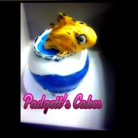 Dr. Seuss Fish Vanilla Cream cake with cotton candy filler and covered in MMF. Fish is made out of MMF.