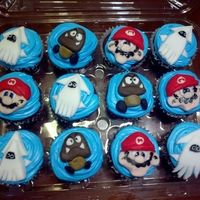 Super Mario Cupcakes Made these for a friend for her son's birthday at school. Chocolate cupcakes with vanilla frosting and fondant decorations.