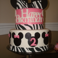 Birthday Cake minnie mouse birthday. used the cricut cake mini to cut out the 'happy birthday'