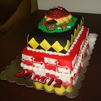 University Of Maryland Graduation Cake turtle is made out of fondant/gumpaste. the design around the tiers reflects the school's flag.