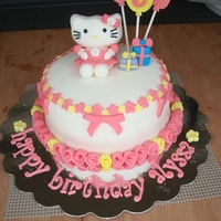 Pink And Yellow Hello Kitty Cake  hello kitty cake for my niece! hello kitty was super easy to mold from fondant/gp. made oval and pinched ends to form ears. for body made a...