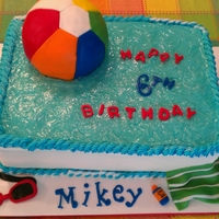 Summer Swimmin' N Birthday Swimming pool with 3d beach ball floating. Fondant goggles, towel, & sunblock.