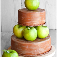 Fall Or Autumn Themed Tiered Apple Cake I learnt so much about structure and support when making this cake. Both the tiers are covered in brown marshmallow fondant. Then, I gave...