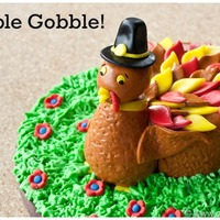 Turkey Cake This was a mini round cake made to look like a cute turkey, wearing a pilgrim hat. All the details are made from fondant. Gobble! Gobble!