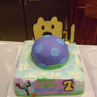 Wow Wow Wubbzy Gumpaste wubbzy and tail, covered in BC, mmf trees and birds. Ball is cake covered in mmf.