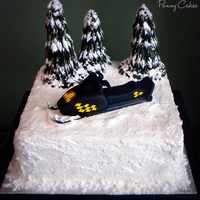 Snowmobile Cake Birthday Cake for my bro, complete with a replica of his sled (fondant) and edible trees! ..Dark Chocolate Fudge cake with Peanut Butter...