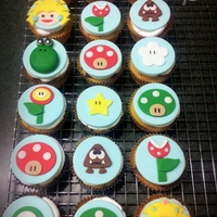 Super Mario Brothers Cake Is Dark Chocolate Fudge With Peanut Butter Filling And Buttercream Icing Cupcakes Are Fudge Marble With Butterc Super Mario Brothers.. Cake is dark chocolate fudge with peanut butter filling and buttercream icing. Cupcakes are fudge marble with...
