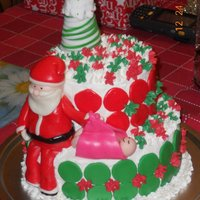 Christmas Baby I was asked to make a cake with santa bringing a baby the way a stork brings a baby for someone whose birthday was on Chistmas. Both tiers...