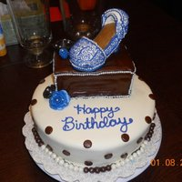 Shoe Birthday Cake Both tiers are WASC covered in MMF. The shoe is RCT covered in MMF and the blue designs are buttercream.