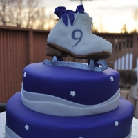 Skate Cake Rainbow (purple/white) vanilla cake, with rice krispie skate; all covered in buttercream and fondant.