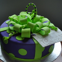 'gift' Cake Bow, number 9 and gift tag are half gumpaste, half fondant.