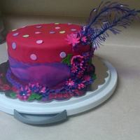 "Red Hat ""hat"" Cake I created this for a Red Hat member who was turning 50. I posted in the forum a question how to make a feather for this cake. I decided to..."