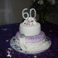 60Th Anniversary Cake This cake is the Moist chocolate cake with raspberry filling. Covered with chocolate Swiss Meringue buttercream frosting.Then white fondant...